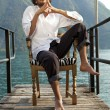 Young man on the dock of Lake — Stockfoto #57806159