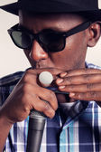 African singer with microphone — Stock Photo
