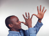 Young African boy with mocking gesture — Stock Photo