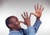 Young African boy with mocking gesture — Foto de Stock