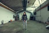 Woman posing in abandoned industrial environment — Foto Stock
