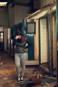 Woman posing in abandoned industrial environment — Stock Photo