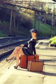 Woman waiting for the train — Stock Photo