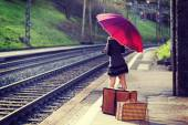 Woman waiting for the train — Stockfoto