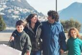 Happy family walking outdoors in city — Stock Photo