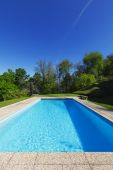 Outside of modern house in summer, swimming pool — ストック写真