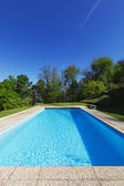 Outside of modern house in summer, swimming pool — Стоковое фото