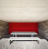Portico with marble table, red wall — Stock Photo