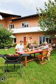 Family having a barbecue in the garden, eating — Stock Photo