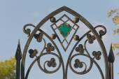 Openwork forged iron fence — Stock Photo