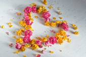 Heart is composed of dried roses — Stock Photo