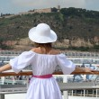 Woman standing near rail on cruise liner deck — Stock Photo #54869245