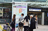 Tourists looking at public map in Rotterdam.tourism, travel and people concept — Stock Photo