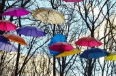Сolorful umbrellas hanging in the air — Stock Photo