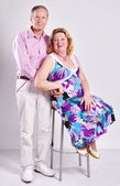 Elderly happy couple .Full length portrait of a happy couple — Stock Photo