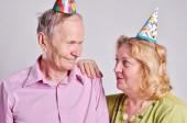 Portrait of mature couple with party hats — Foto de Stock