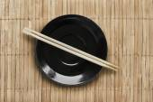 Plate and chopsticks — Stock Photo