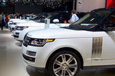 """MOSCOW - 29.08.2014 - Automobile Exhibition """"Moscow International Automobile Salon""""- white off-road vehicles standing in a row — Stock Photo"""