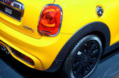 """MOSCOW - 29.08.2014 - Automobile Exhibition """"Moscow International Automobile Salon""""- a rear view of yellow car with red lights — Stock Photo"""
