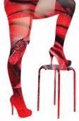 Double exposure-female legs in roses — Stock Photo