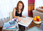 Attractive girl with freckles study at home — Stock Photo