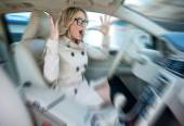 Woman driver in road rage — Stock Photo