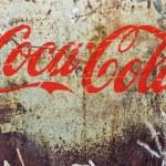 Coca cola old rusty logo — Stock Photo #73897215