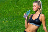 Attractive girl drinking water — Stock Photo