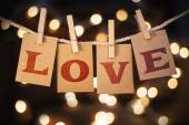 Love Concept Clipped Cards and Lights — Stock Photo
