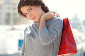 Woman in yachts port with shopping bags — Stock Photo