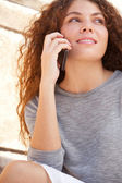 Young woman using a smartphone — Stock Photo