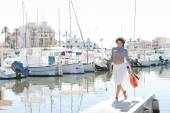 Woman on yachts marine pier — Stock Photo