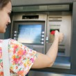 Woman using a cash point machine — Stock Photo #76273547