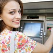 Woman using a cash point machine — Stock Photo #76273721