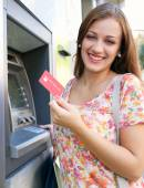 Woman using a cash point machine — Stock Photo