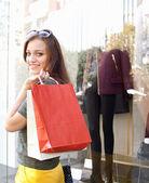 Woman carrying shopping bags — Stock Photo
