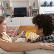 Couple watching television, eating pop corn — Stock Photo #77843304
