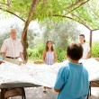 Family getting ready for eating lunch outdoors — Stock Photo #78500792