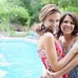 Teenager daughter and her mother hugging — Stock Photo #78500870