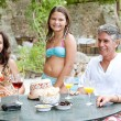 Family posing for a photograph during a vacation together — Stock Photo #78500888