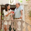 Couple drinking wine in the resort — Stock Photo #78500938