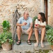 Couple drinking wine in the resort — Stock Photo #78500954
