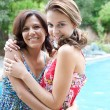 Teenager daughter and her mother hugging — Stock Photo #78500984