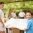 Family getting ready for eating lunch outdoors — Stock Photo #78500986