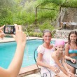Family posing for a photograph during a vacation together — Stock Photo #78501026