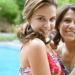 Teenager daughter and her mother hugging — Stock Photo #78501112