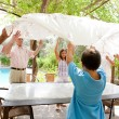 Family getting ready for eating lunch outdoors — Stock Photo #78501556