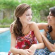 Teenager daughter and her mother hugging — Stock Photo #78501594