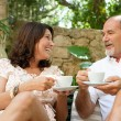 Couple drinking coffee and tea together — Stock Photo #78501666