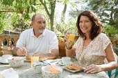 Couple having breakfast together — Stock Photo